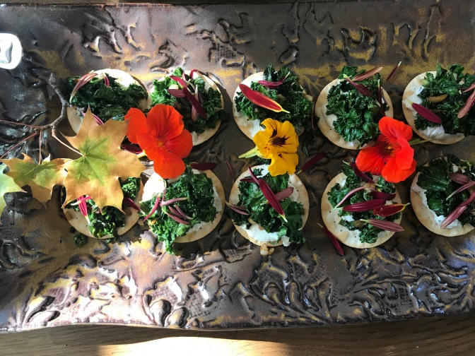 Curly Kale and Ricotta Salata on Crackers with Chrysanthemum Petals